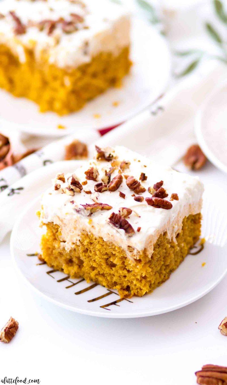 slice of pumpkin poke cake with pumpkin filling