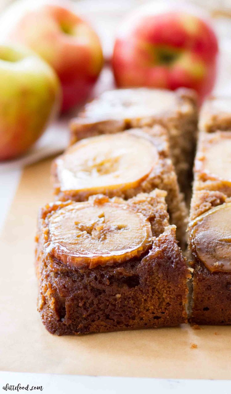 apple upside down cake cut in slices on brown parchment paper