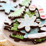 cutout chocolate sugar cookies with royal icing on white plate