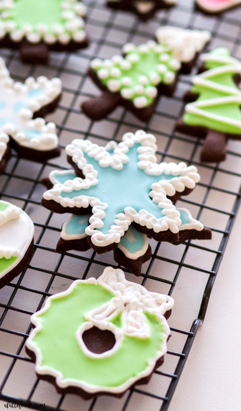royal icing sugar cookies stacked on cooling rack