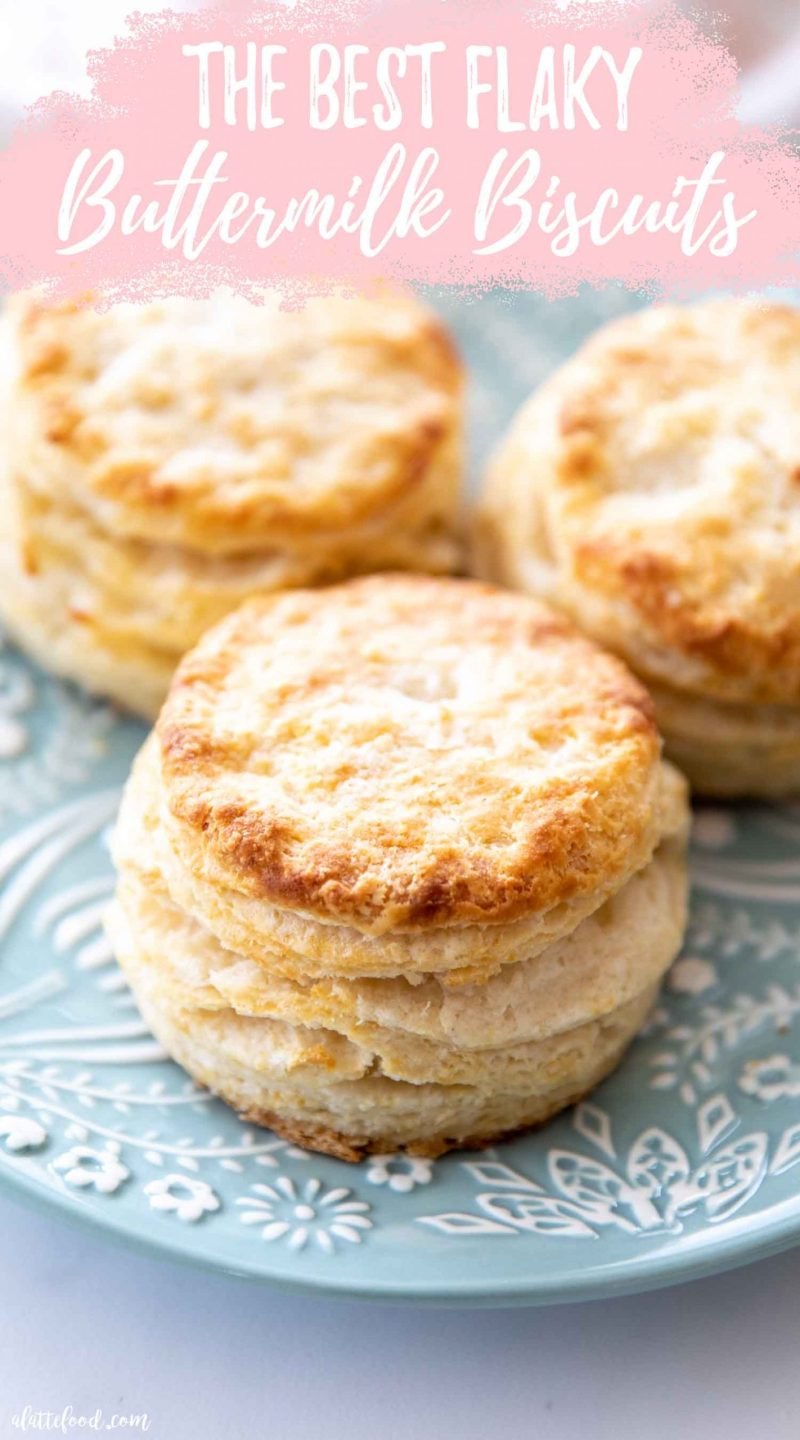 baked flaky buttermilk biscuits on a teal plate