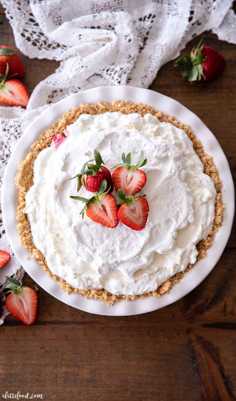 Graham cracker crusted strawberry marshmallow pie in white pie dish