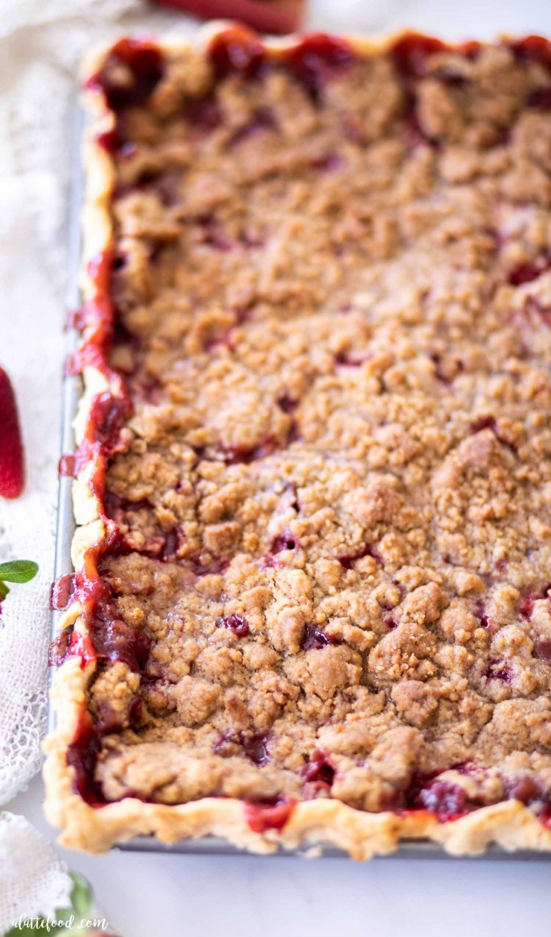 baked crumb topped strawberry rhubarb pie in sheet pan