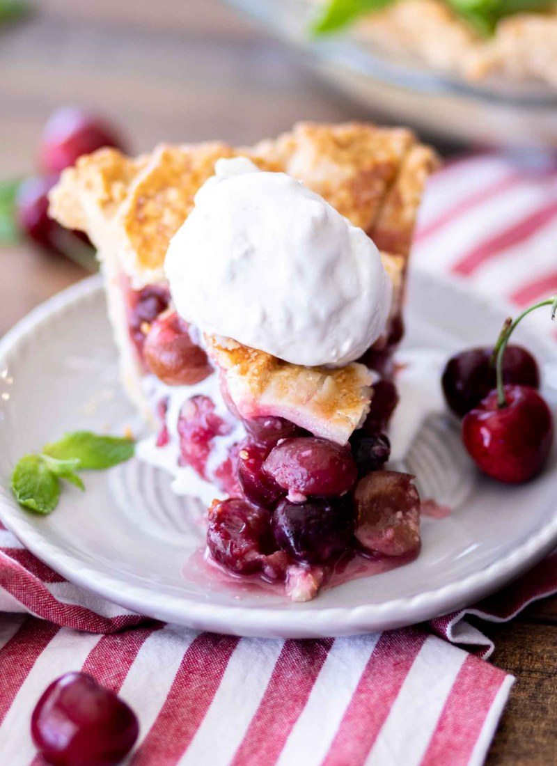 slice of cherry pie a la mode on a grey plate