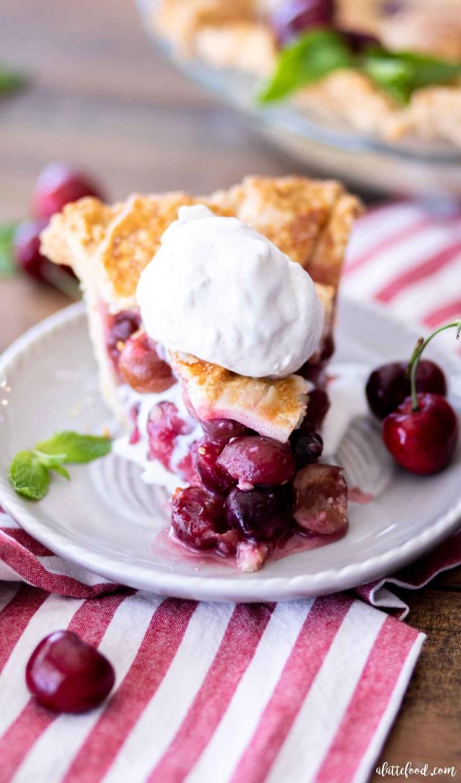 slice of cherry pie a la mode on a grey plate