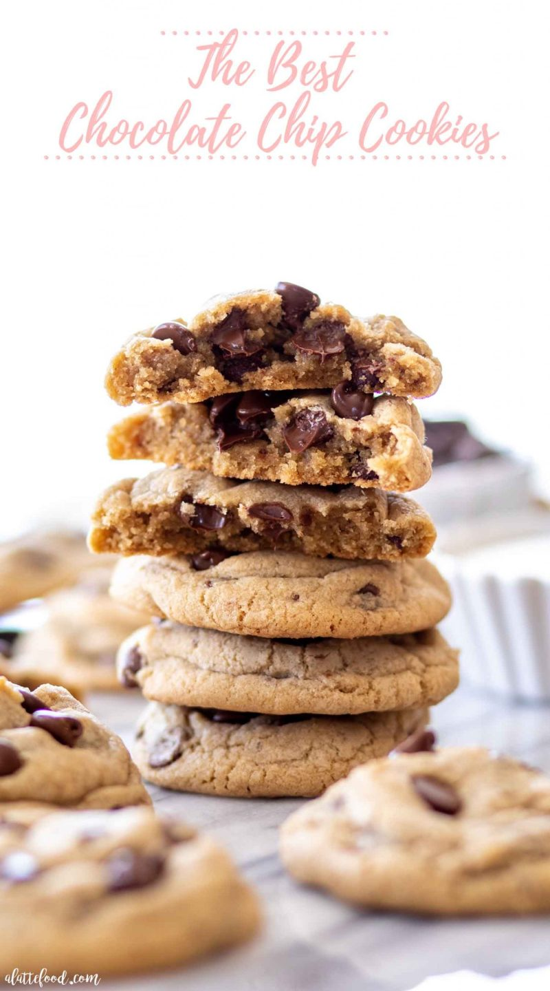 tall stack of chocolate chip cookies on marble slab with text