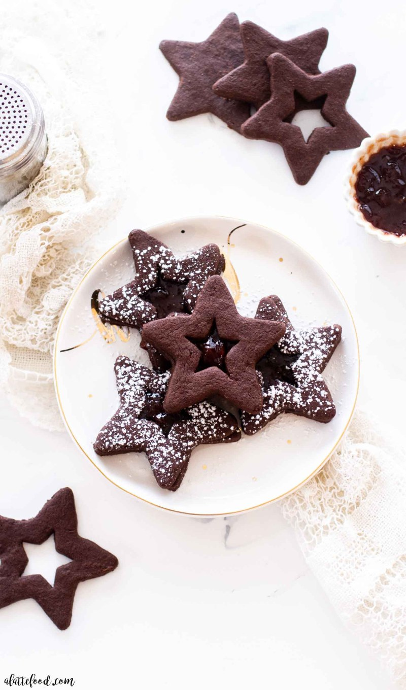 jam filled chocolate cookies on a white plate