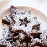 powdered sugar chocolate sandwich cookies with a strawberry jam filling