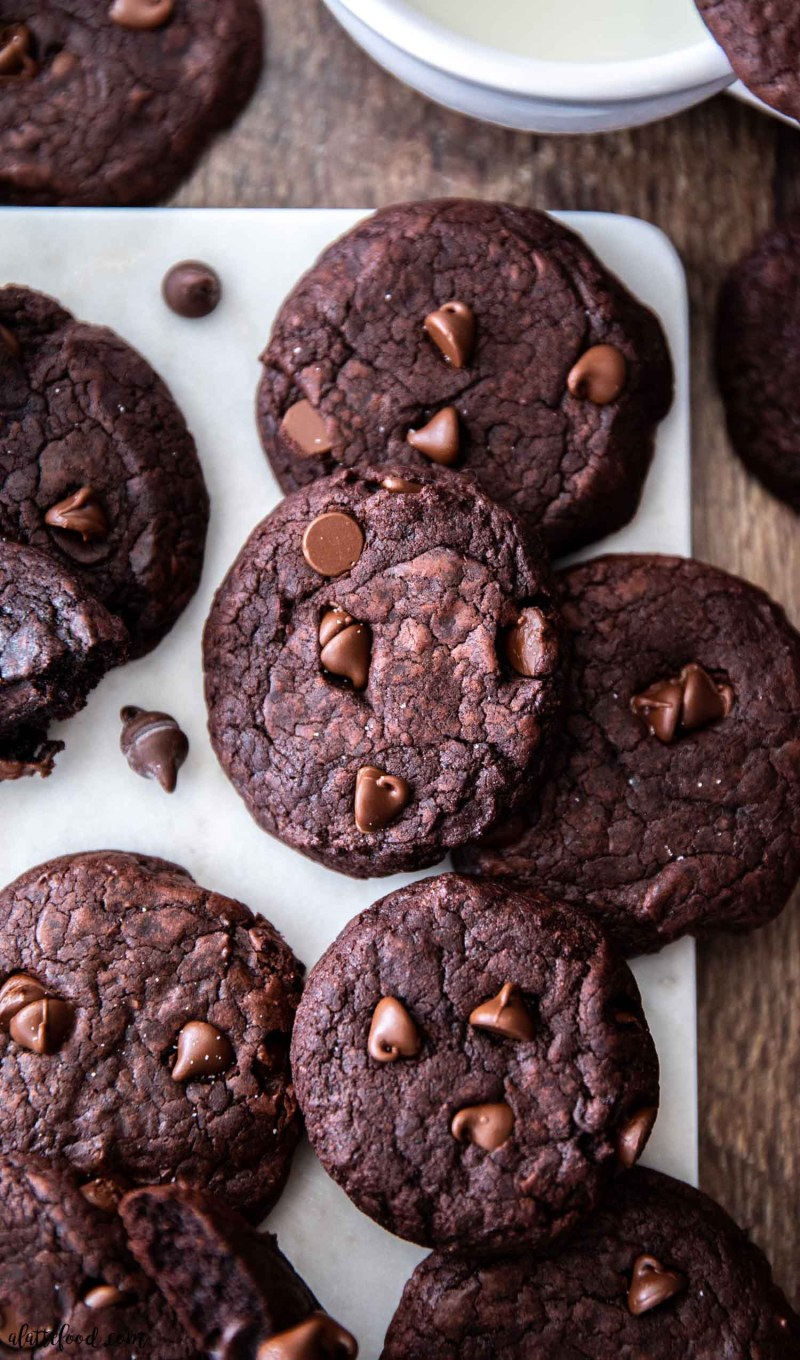 fudgy chocolate cookies baked and on a marble cutting board