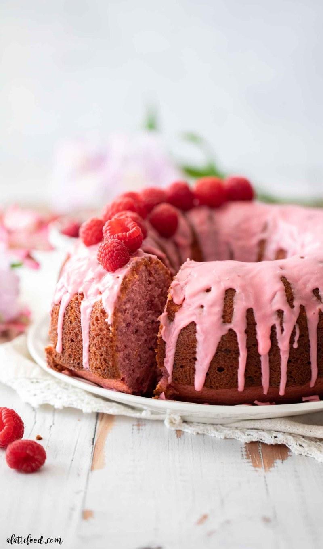 slice of raspberry bundt cake with fresh raspberries on top
