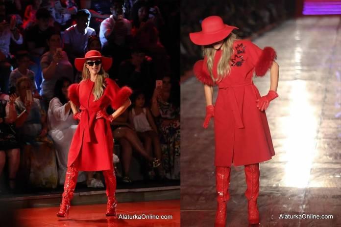 Paris Hilton almost falls during Dosso Dossi Fashion Show