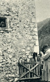 GM044: Giuseppe Massani photographing a child in Theth, with Father Anton Kiri on the right (Photo: Giuseppe Massani, 1940).