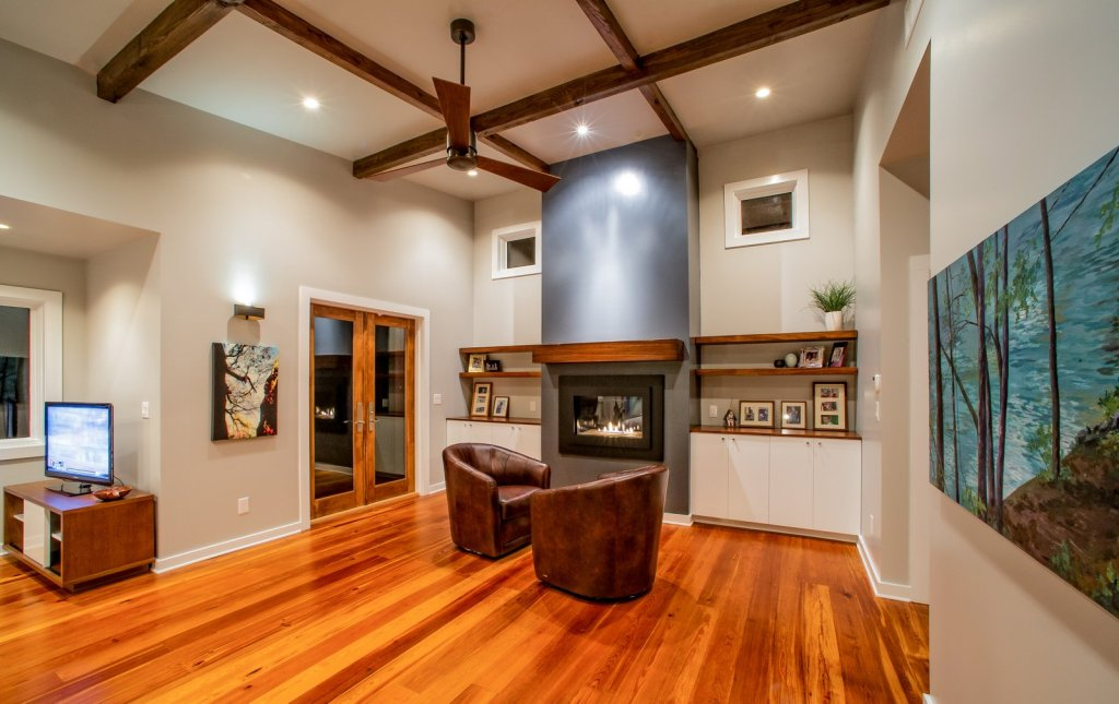 Antique heart pine flooring exposed beams living room