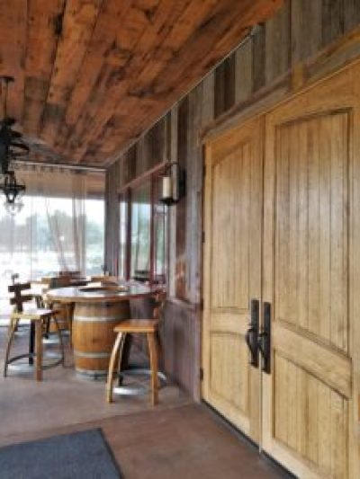 rustic reclaimed wood ceiling and wood paneling