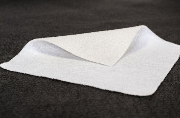 scrim to reinforce and support felts for enhanced puncture resistance and minimal stretch