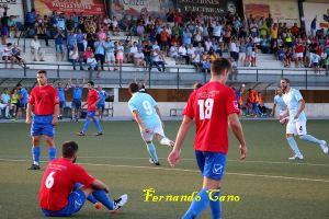Miguel Ruiz celebra uno de sus dos goles al Adra   Fernando Cano
