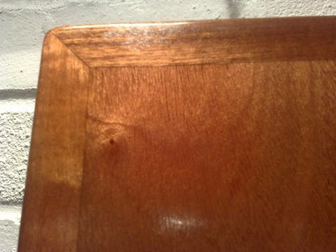 Close up of locker hatche post varnish