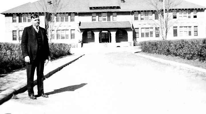 Photo of Harper Donaldson standing in front of Donaldson Hall