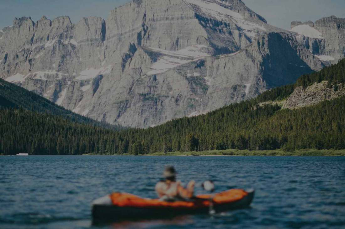Man canoeing in mountains