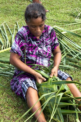 weaving coconut frond