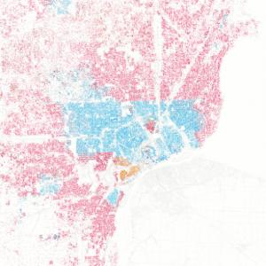 En azul las zonas de los negros en el centro de Detoit y en rojo las zonas residenciales donde están concentrados los blancos.
