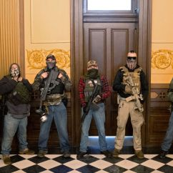 A militia group with no political affiliation from Michigan stands in front of the Governors office after protesters occupied the state capitol building during a vote to approve the extension of Governor Gretchen Whitmer's emergency declaration/stay-at-home order due to the coronavirus disease (COVID-19) outbreak, at the state capitol in Lansing, Michigan, U.S.