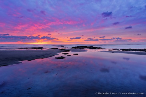 Vibrant sunset sky reflecting in the tide pools at Tabletop Reef, Seaside State Beach, Cardiff By The Sea, California. December 2011.