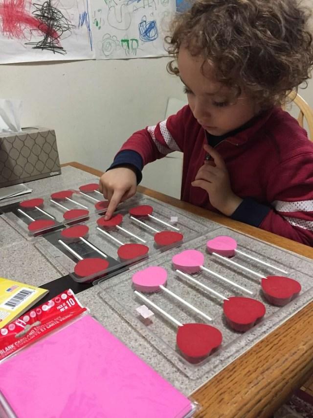Alexander making chocolate lollipops