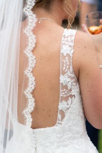 wedding photo of the detailing on the back of the bride's dress