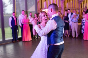 wedding photo of a bride and groom enjoying their first dance