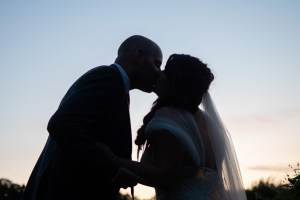 wedding photo of couple kissing