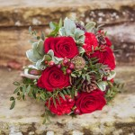 Wedding bouquet with red roses and green foliage