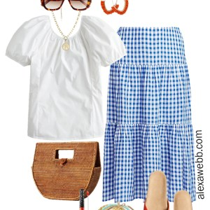 Plus Size Gingham Skirt Outfit with white puff sleeve top, orange sandals, straw clutch, and statement earrings - Alexa Webb