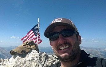 Geoff Gilmer Places Flag at Summit of Mt. Princeton for Alex