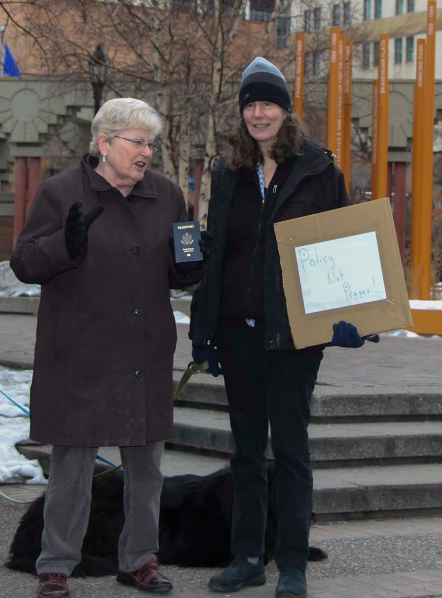 Elizabeth Jameson (left) and Jewel Spangler (right), both American history professors at the University of Calgary chat during a March For Our Lives rally against U.S. gun violence in downtown Calgary, March 24, 2018. Dr. Jameson is holding a U.S. passport. (Full disclosure: I was in many classes with these profs at U of C.) (Alex Hamilton/SAIT.)