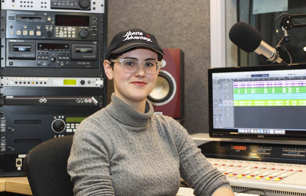 Kate Jacobson, host and producer of the Alberta Advantage podcast, ready to edit an episode in the CJSW 90.9 FM studio at the University of Calgary on Thursday, Dec. 6, 2018. The podcast, which started about a year prior, had $565 a month in crowdfunded subscriptions. (Photo by Alex Hamilton)