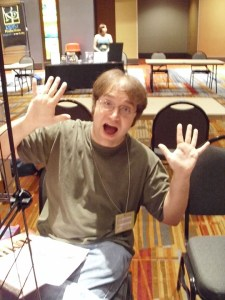 Chris sitting behind my table, very excited.