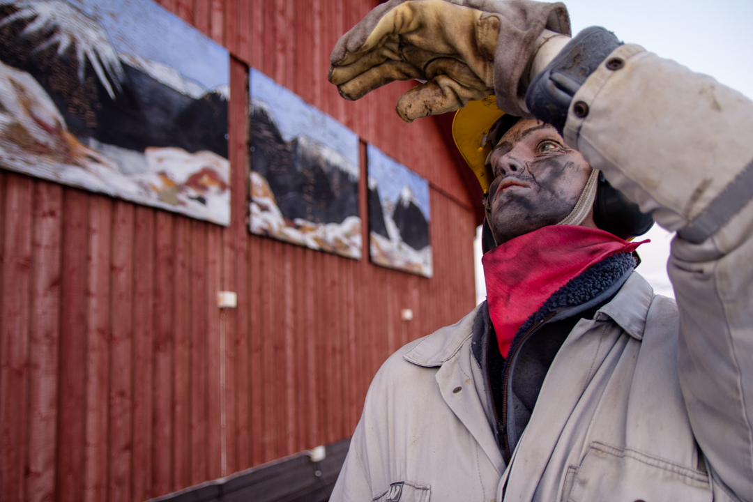Statue of a miner in longyearbyen
