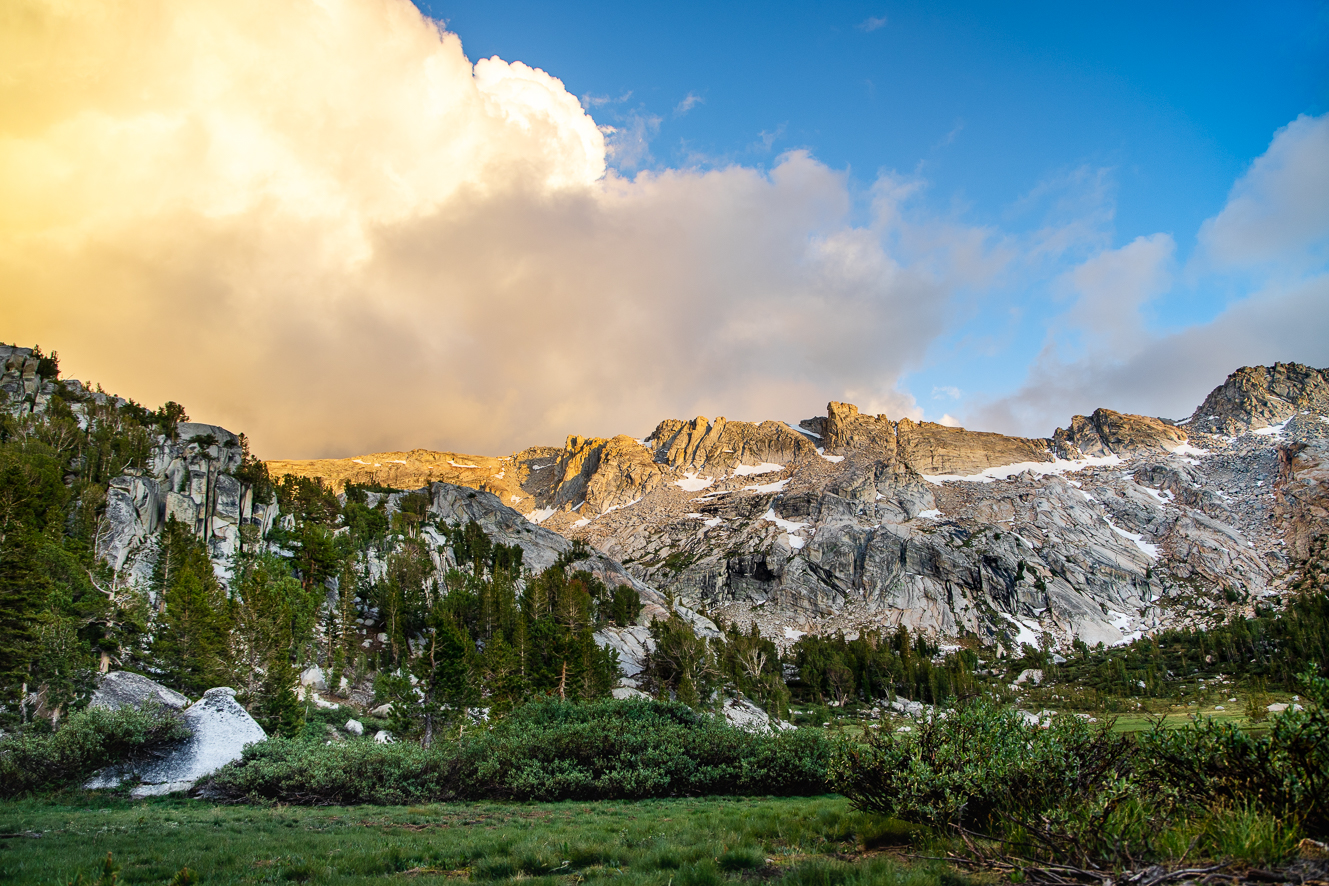 Giant clouds move across granite clifftops at 10,000 feet in Yosemite National Park.