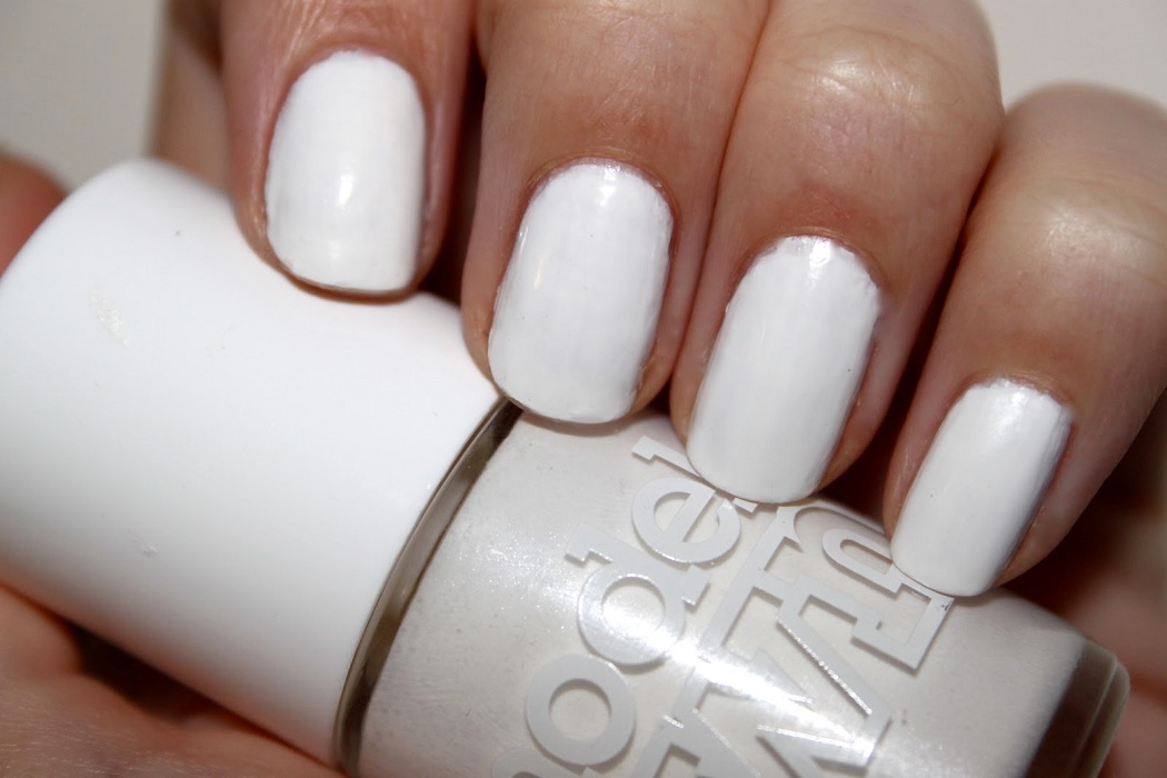 creme white models own nail varnish