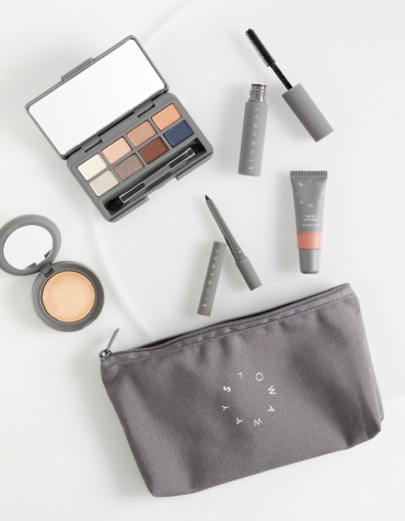 essentials for eyes, lips and face with cosmetics bag