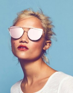 Modern shaped cat eye aviators featuring metal frames and an edgy eyebrow bar