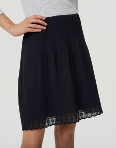 High-waisted daisy embroidered pin tuck black skirt