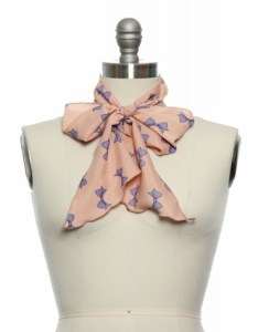 Peach scarf with purple bow pattern