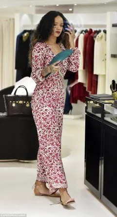 Rihanna in a sleeved red and white maxi dress shopping