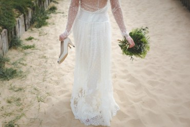 Bride walking on sand- wedding dress