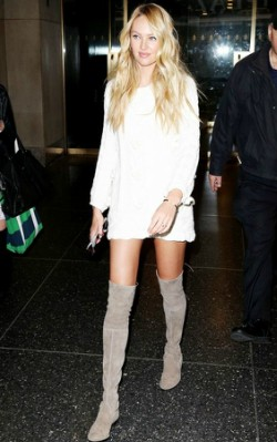 Candice Swanepoel street style in white long sleeved dress and grey over the knee boots