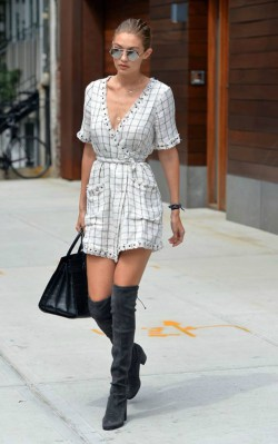 Gigi Hadid black and white wrap dress with grey over the knee boots