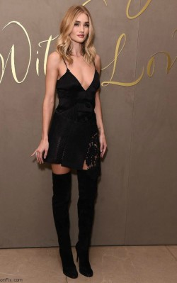 Rosie Huntington in black dress with v-neck paired with over the knee boots