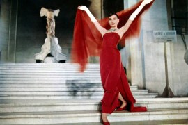 Audrey Hepburn wearing long red dress in funny face scene